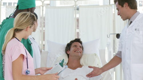 hospital team joking with a patient