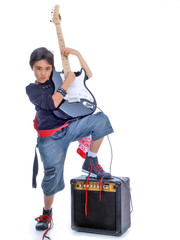 boy playing guitar leaning on the amplifier