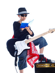 child rock star signing autograph isolated on white background