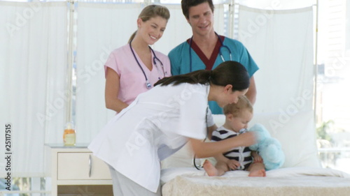 Thoughtful Hospital personnel with a baby