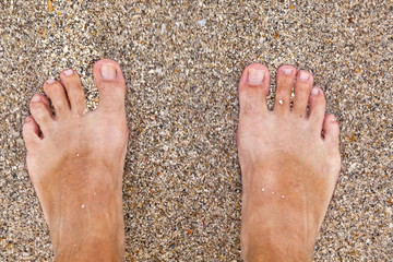 feet of man at the beach