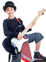 smiling boy playing e guitar isolated on white background