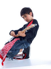 smiling boy with electric guitar
