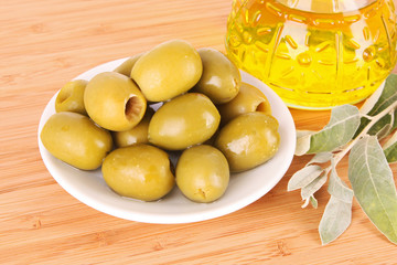 Olives and a bottle of oil