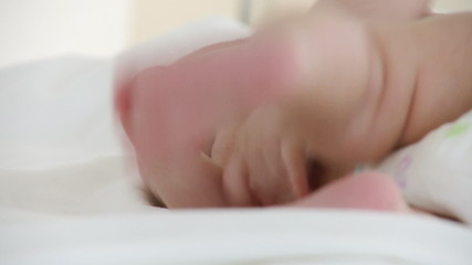 cute new born baby lying on a bed