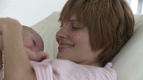 Joyful young mother with her baby in a hospital