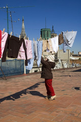 portrait of a sweet girl with the clothesline. urban scene