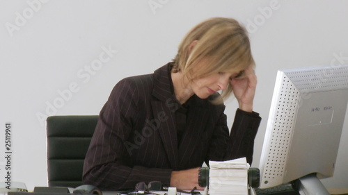 Business-woman frustrated at her computer crashing