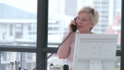 Senior businesswoman on her phone