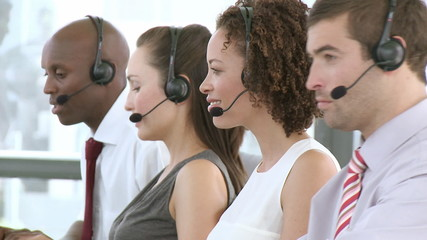 Obliging Business team talking on  headsets