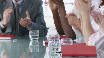 close-up of a business team clapping in a presentation