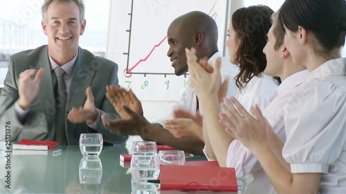 Businessteam with team-spirit clapping in a presentation