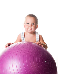 Little boy with the fitness ball