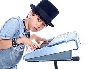 boy playing electric music keyboard isolated on white