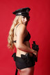Sexy police officer with a gun