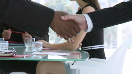 Handshake in a business meeting
