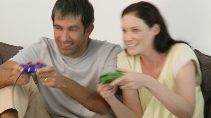 Happy couple playing a TV game