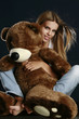 Young pretty woman with big teddy bear