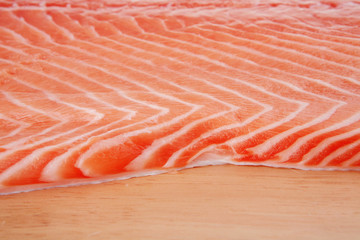 fresh raw salmon fillet on wood