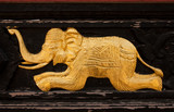 Elephant in native Thai style wood carving art