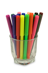 Multicolored felt tip pens in a glass