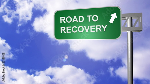 signpost showing the way to recovery on the road