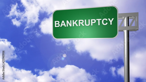 signpost on the road annoucing bankruptcy