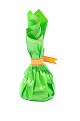 Studio shot of chocolate sweet in green package isolated.