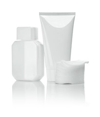 white ceramical bottle and tube with cotton pads