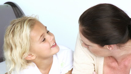 cute girl speaking with her mother