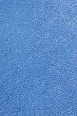 Blue plush terry cloth turkish bath towel macro background close