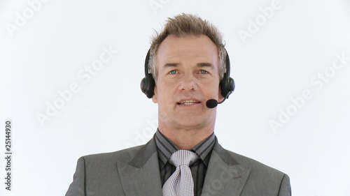 senior businessman talking with headset