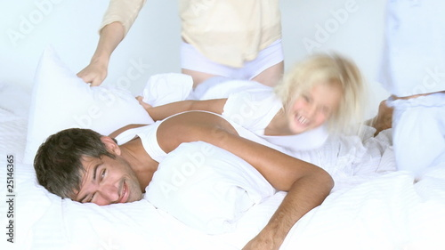 happy family having pillow fight