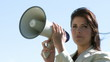 Businesswoman giving intsructions with a megaphone