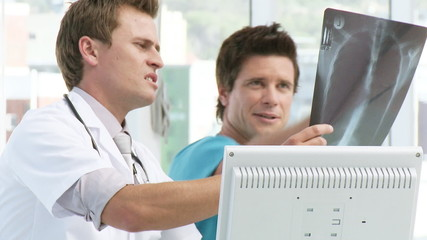 two handsome doctors looking at an x-ray