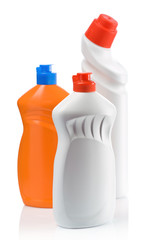 orange and white bottles for cleaning