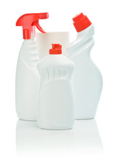 three white bottle with red cover and towel