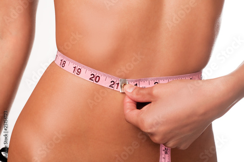Slim woman measuring waist