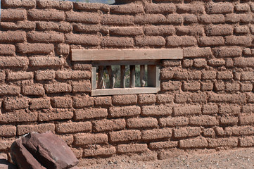 Adobe wall with window