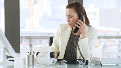 attractive businesswoman taking notes on phone