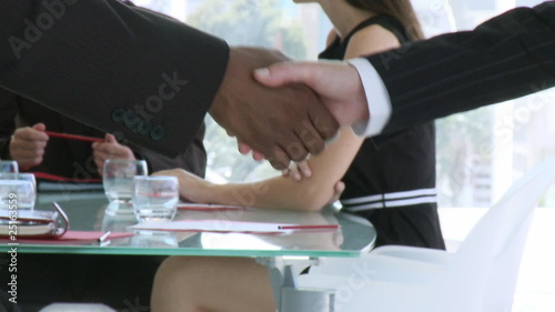 close-up of a handshake during a meeting