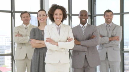 cheerful mutli-ethnic Business team standing with folded arms