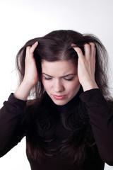Sad young woman. Headache