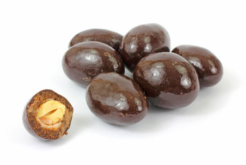 Milk chocolate covered almonds with one bitten in half