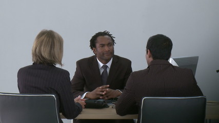 manager discussing with associates