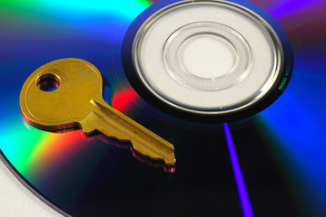 Key on a CD isolated on white concepts of data security