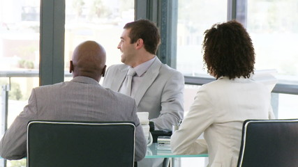 young businessteam laughing during a meeting