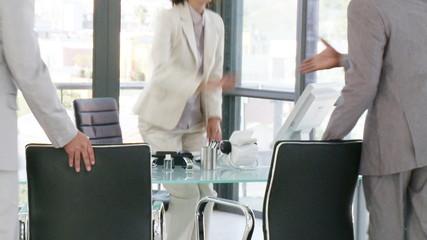 businesswoman receiving businessmen