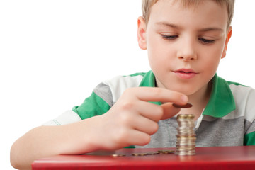 boy in striped T-shirt  stacking up coins  isolated