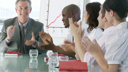businessteam clapping after meeting